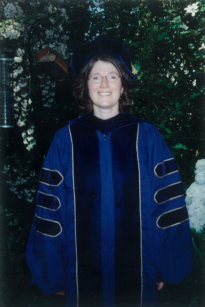 Laura Hathaway as a new doctoral graduate.
